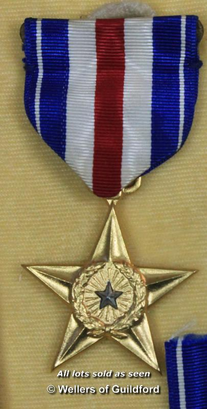 Lot 7189 - *American silver star medal with ribbon and lapel pin, in original box