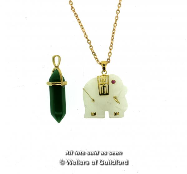 Lot 7026 - Carved elephant pendant and a green stone pendant