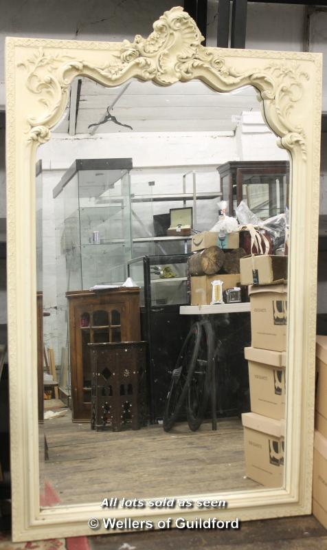 Lot 7300 - A large modern antique style cream framed mirror with ornate scrolling frame and bevelled plate, 170