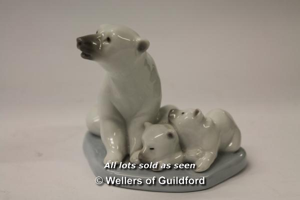 Lot 7277 - Lladro Inuit child with polar bear cub; three Lladro polar bear figure groups with adult and cubs (