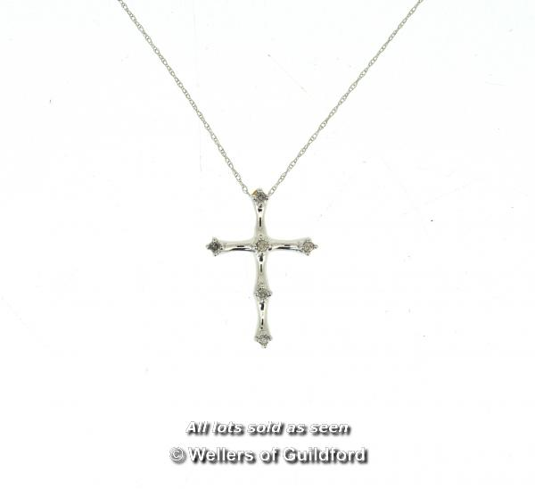 Lot 7005 - Diamond set cross and chain, six round brilliant cut diamonds mounted in a white metal cross,