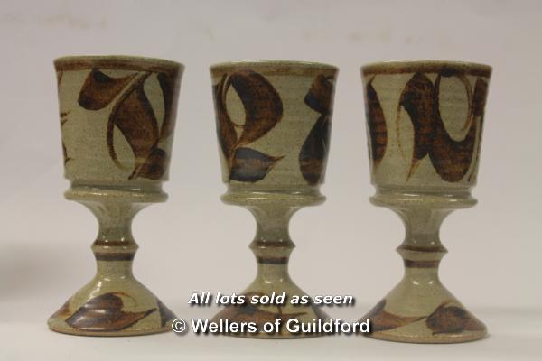 Lot 7522 - Aldermaston studio pottery: A set of six glazed goblets, makers mark on the base (6)