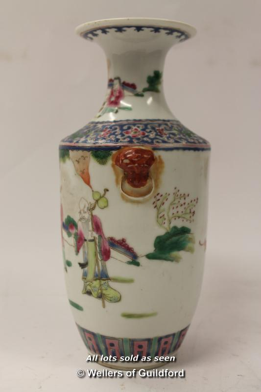 Lot 7335 - *A 19th Century porcelain vase depicting figures in a garden, 22cm.