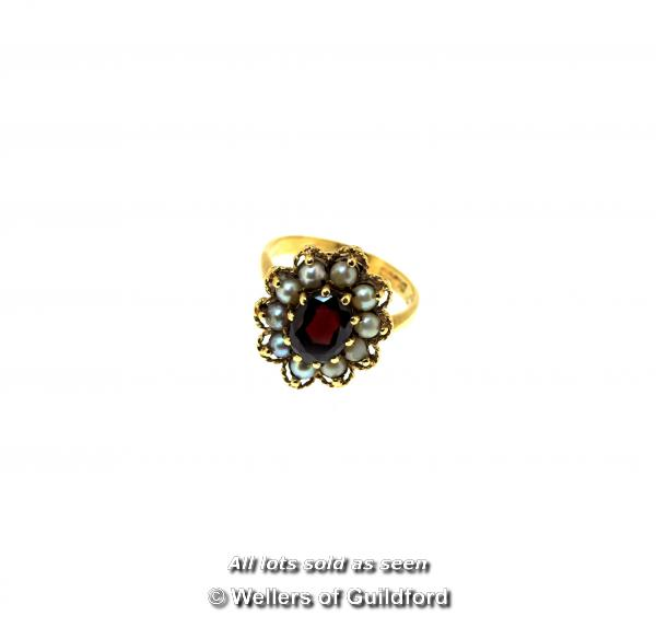 Lot 7063 - *Antique garnet and seed pearl cluster ring, oval cut garnet with a surround of seed pearls and a