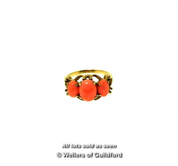 Lot 7064 - *Coral ring, three oval cut coral stones mounted in an ornate 9ct yellow gold design, gross weight