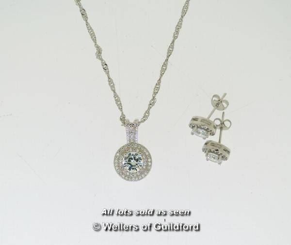 Lot 7030 - Cubic zirconia halo earrings and pendant necklace set, in white metal stamped as silver, length of