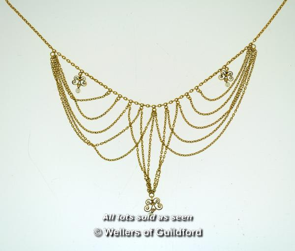 Lot 7067 - *Antique delicate fringe necklace set with three small pearls drops, in yellow metal tested as