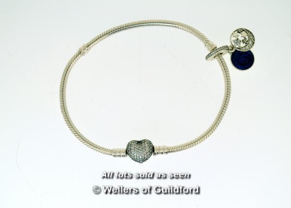 Lot 7073 - Pandora charm bracelet with white stone set heart clasp and one charm, length 21cm
