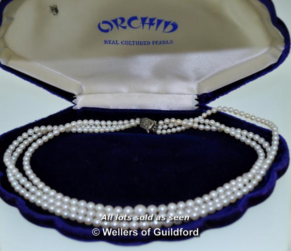 Lot 7066 - *Vintage three row pearl necklace with white metal clasp stamped 9ct, set with a small rose cut