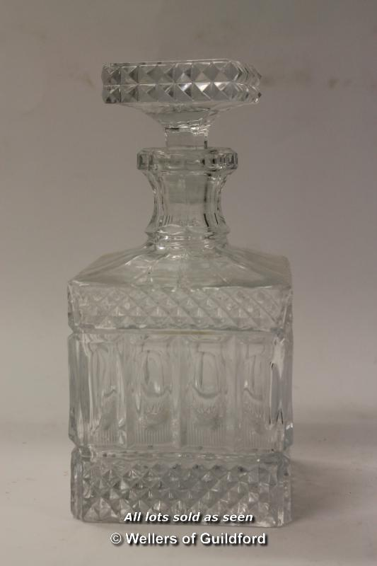 Lot 7287 - Cut glass wares: heavily cut square form decanter, two further decanters, square section scent