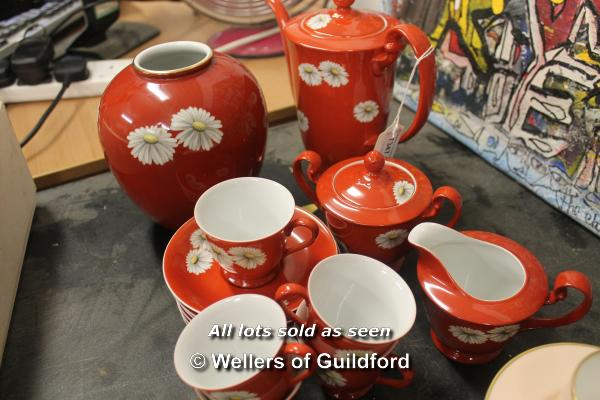 Lot 7347 - Noritake, 7 coffee cans and six saucers; Japanese red ground coffee set decorated with flowers.