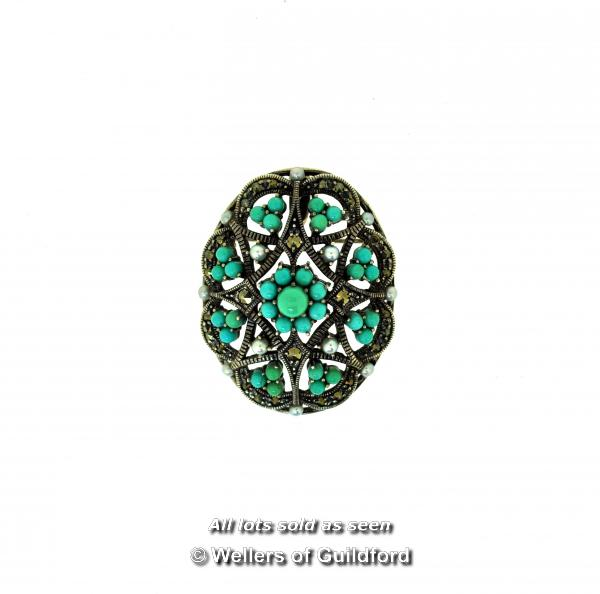 Lot 7054 - *Oval silver openwork brooch/pendant set with turquoise and seed pearls, 35mm x 28mm, gross weight
