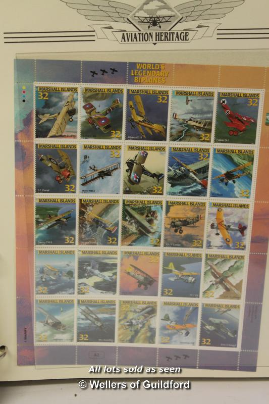 Lot 7297 - Two stamp albums containing Birds of the World and Aviation Heritage collections.