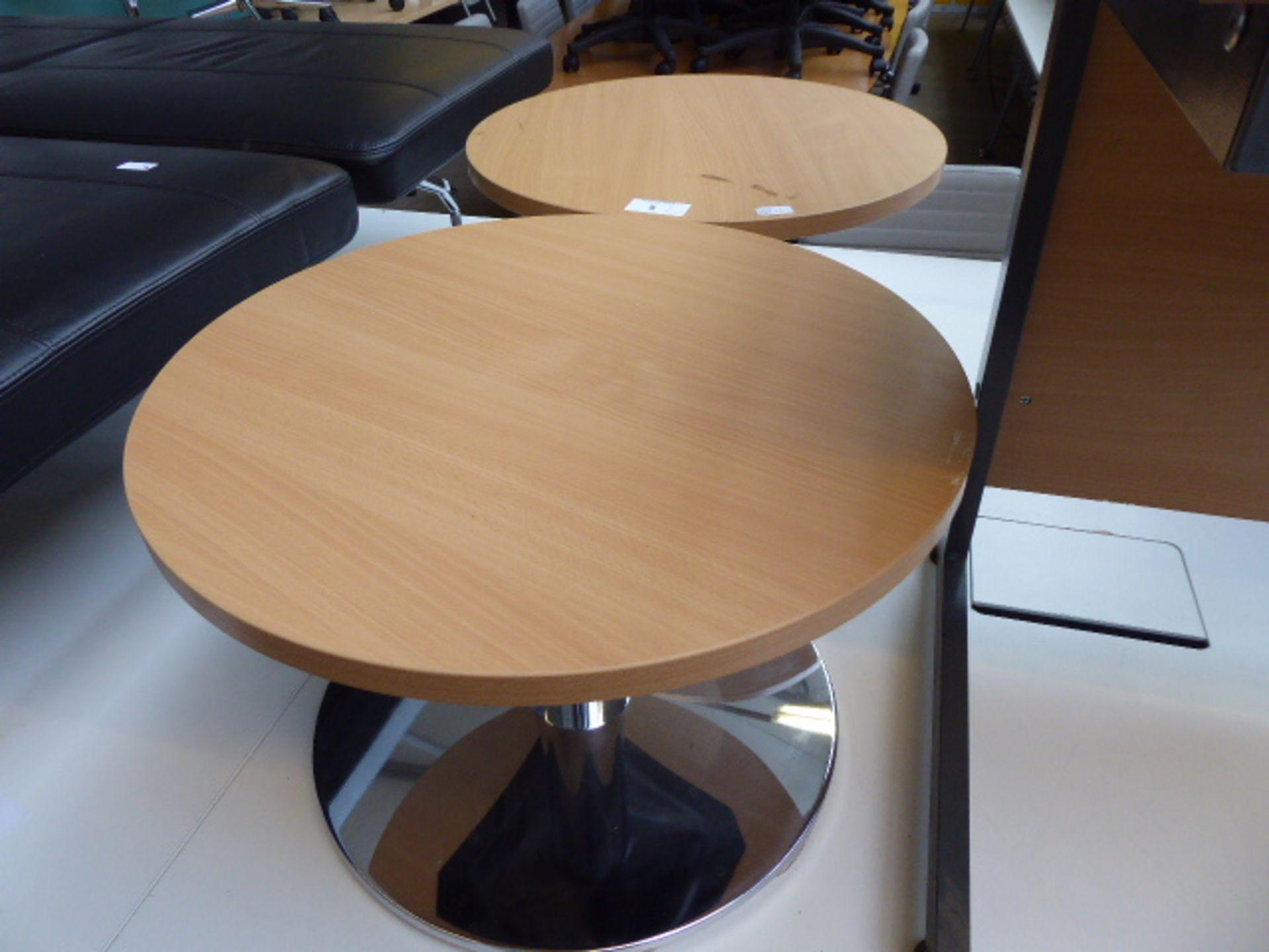 Lot 5 - Two oak effect low circular coffee tables 60cm diameter