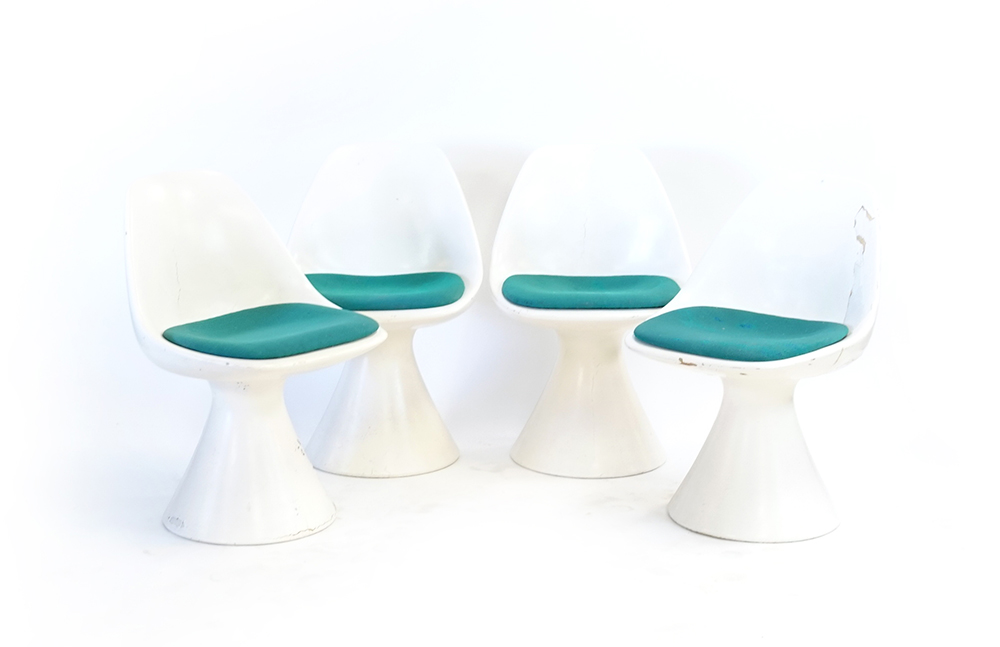 Lot 8 - A set of four 1960's Arkana white moulded chairs on tulip-type bases CONDITION REPORT: