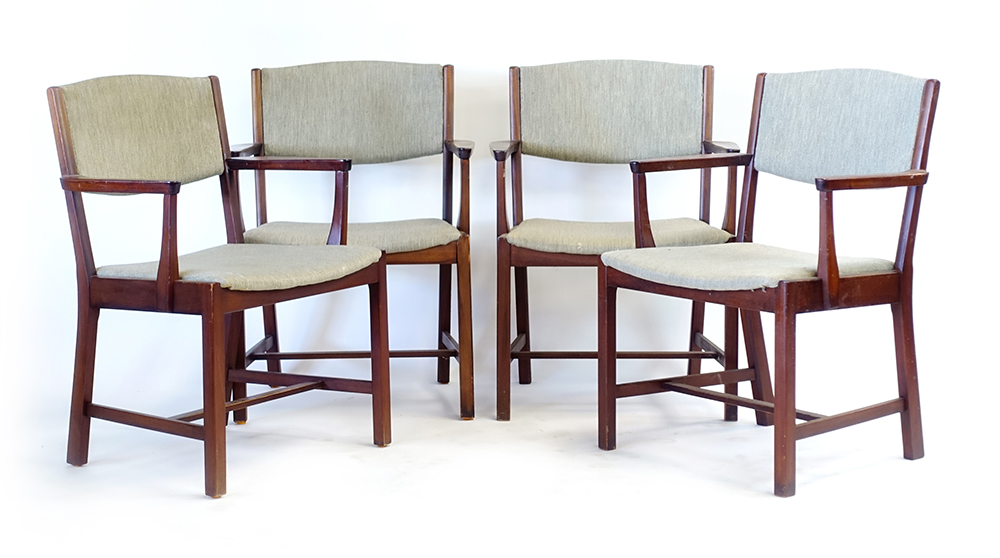 Lot 32 - A set of four 1960's mahogany and upholstered elbow chairs