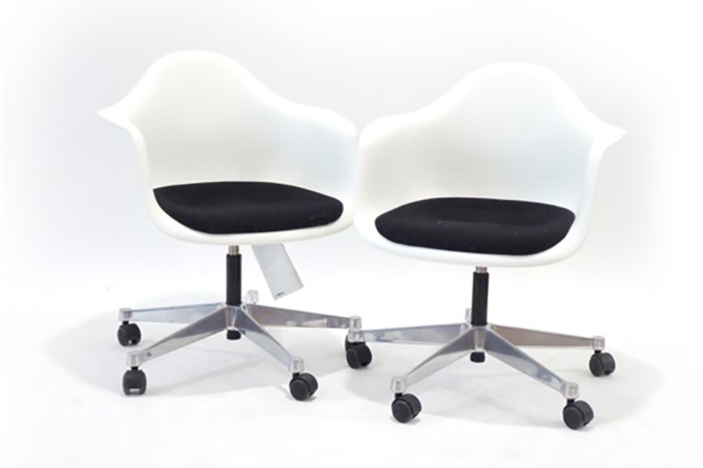 Lot 16 - Charles and Ray Eames for Vitra, a pair of 'Eames Plastic Chair' with white moulded shells,