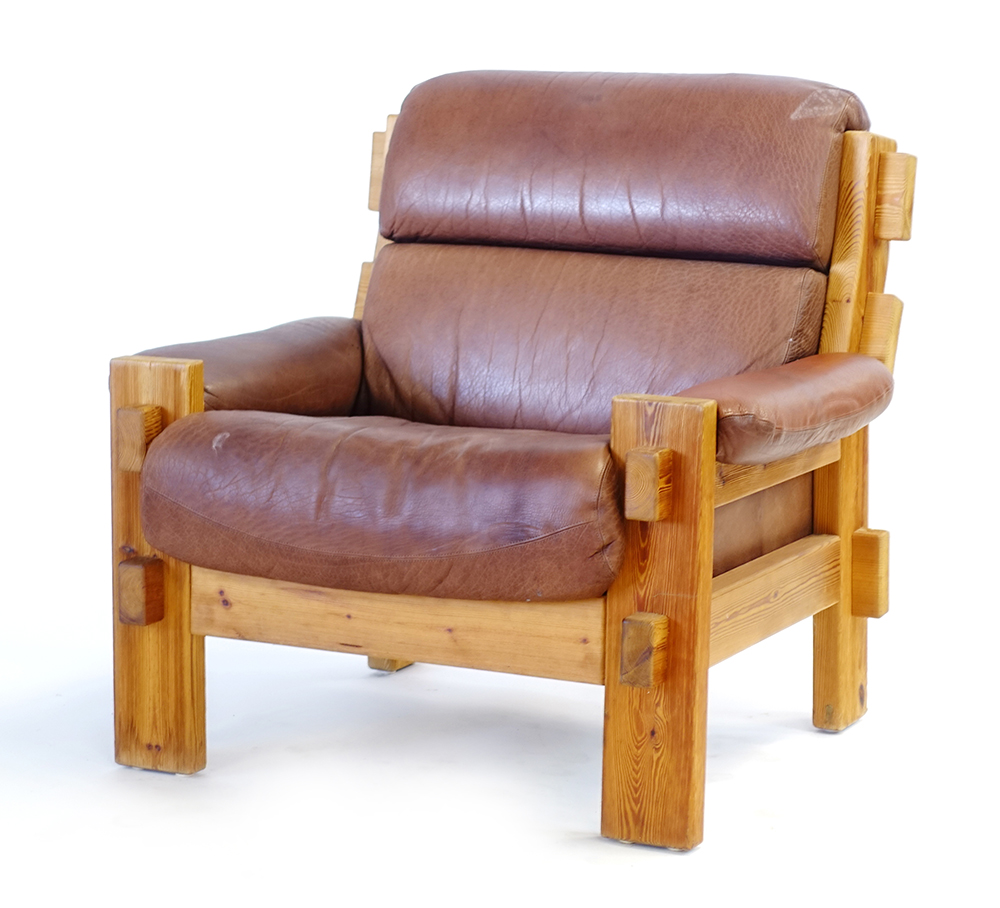 Lot 54 - A 1960/70's rustic pine framed lounge armchair with brown leather upholstery CONDITION