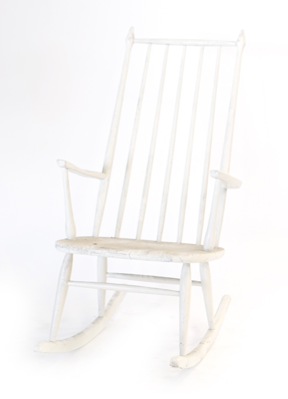 Lot 5 - A white painted spindle back rocking chair