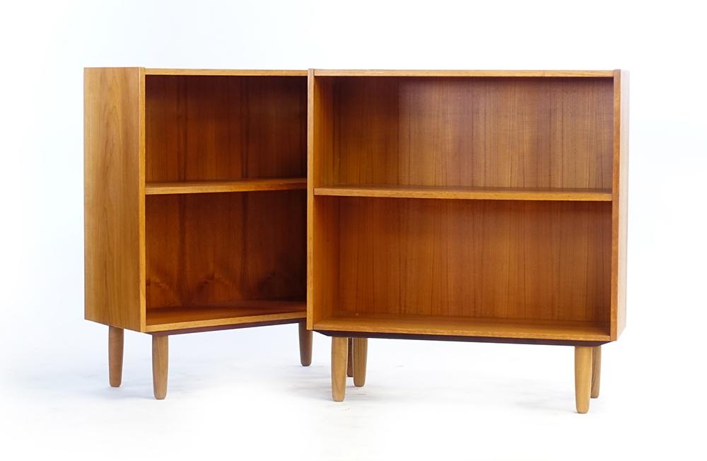 Lot 27 - A pair of 1960/70's teak open bookcases, on beech legs, w.