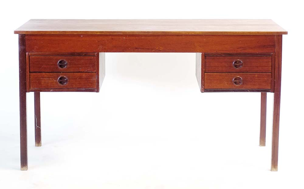 Lot 35 - A 1960's Danish teak and crossbanded desk, the four drawers with moulded integral handles,