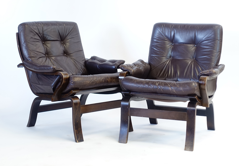 Lot 60 - A pair of 1970's brown button upholstered lowback armchairs on bentwood frames,