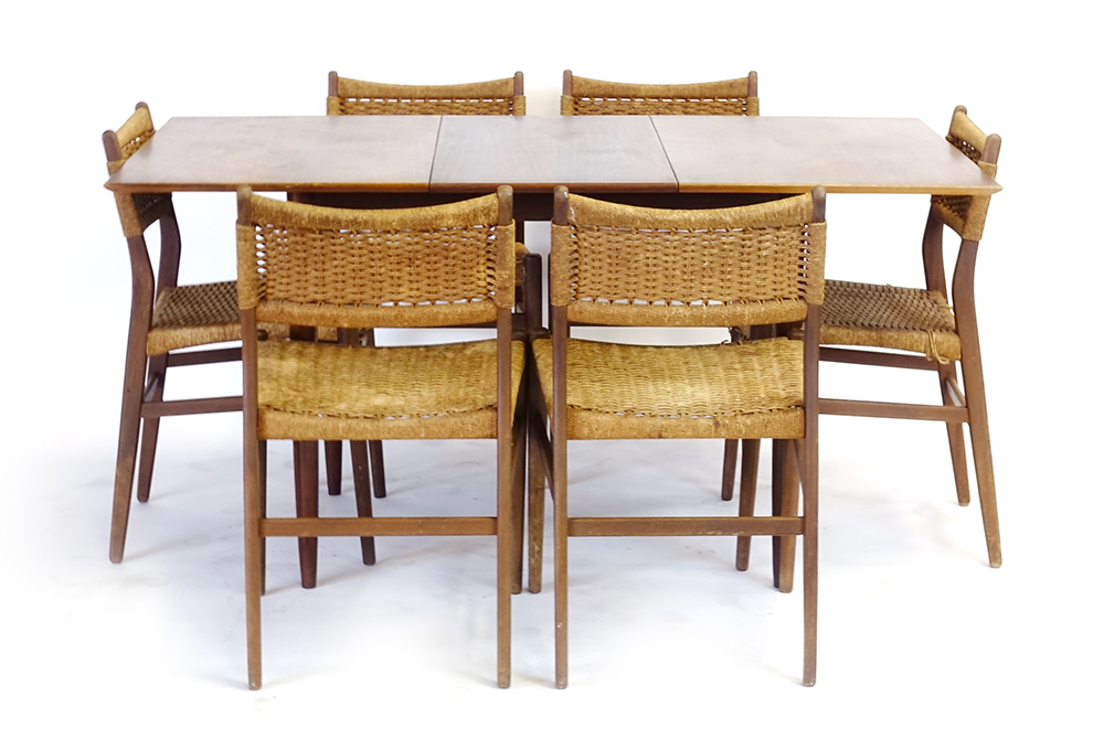 Lot 59 - A 1960's dining suite including six teak and seagrass chairs and a walnut finished extending table,