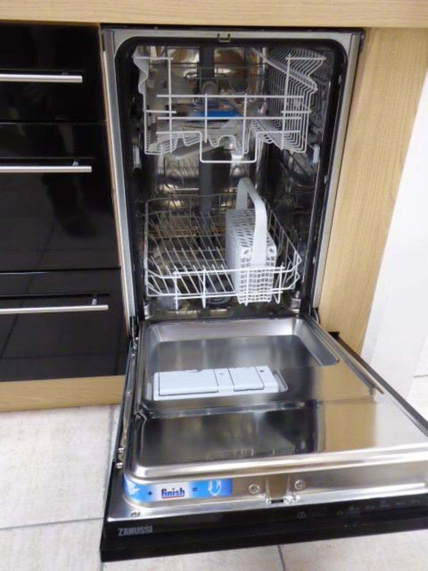 Lot 7 - Alto gloss black galley kitchen measuring 370cm long with light oak wood laminate worktops. With a 1