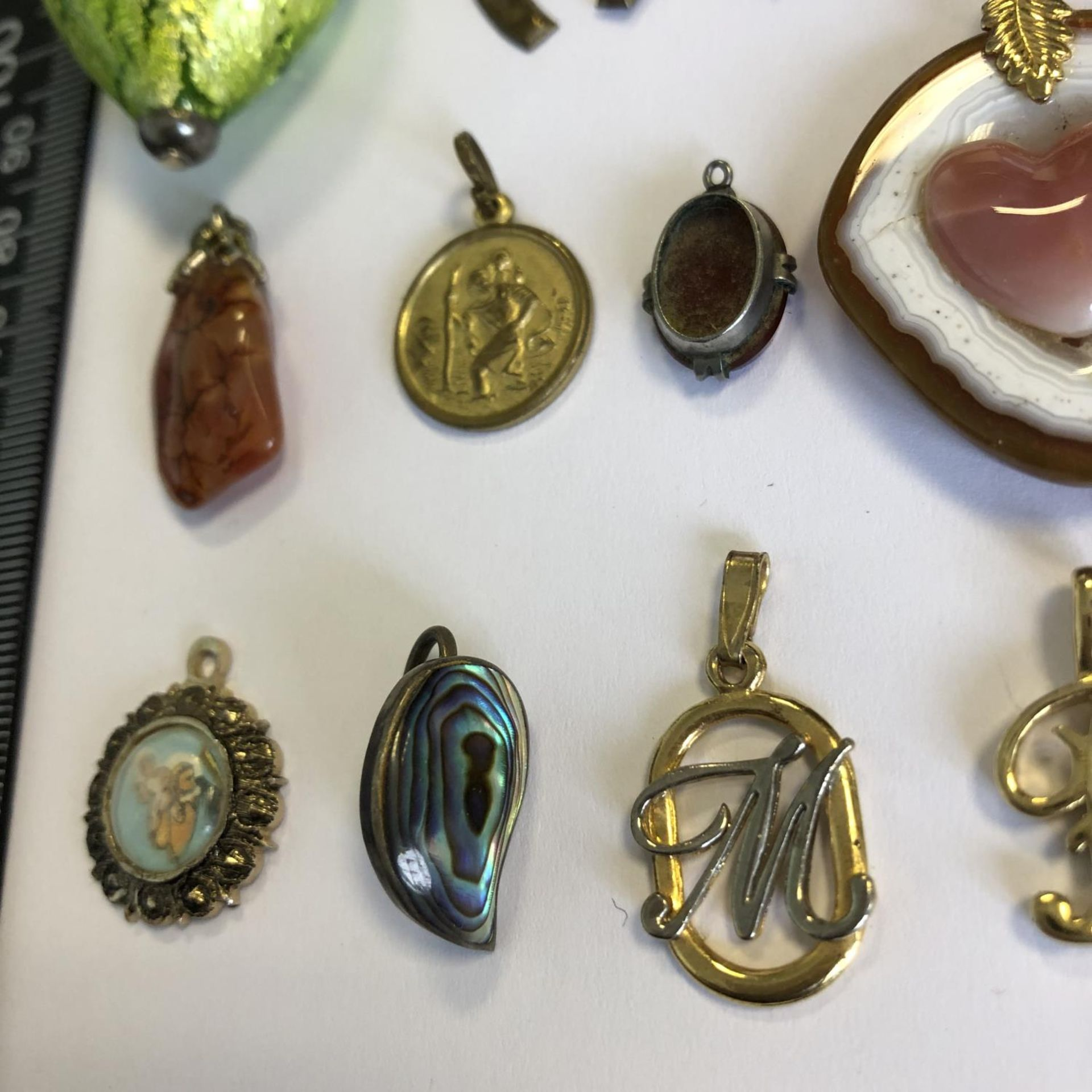 Lot 28 - A group of vintage costume jewellery pendants - (15) - No reserve