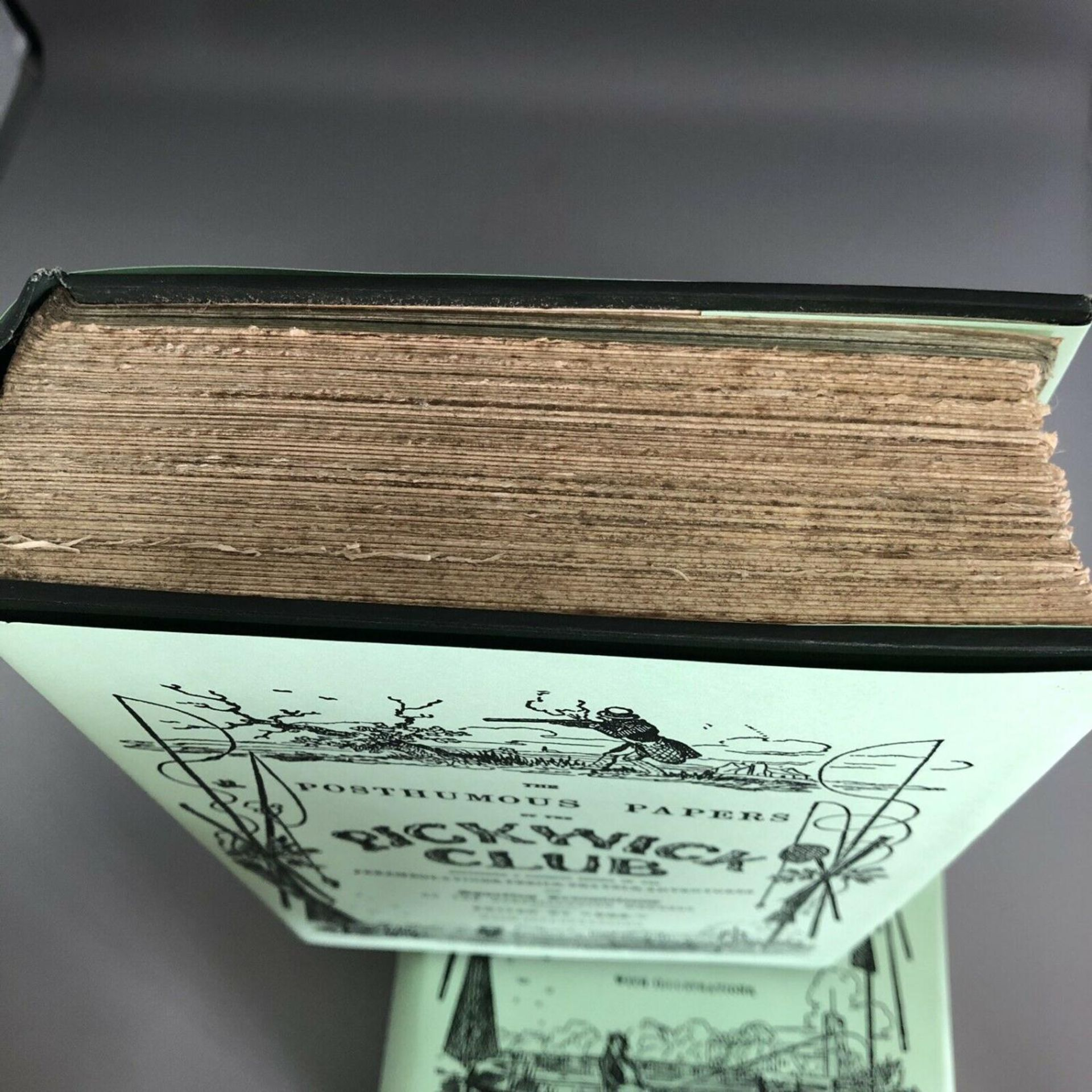 Lot 54 - Charles Dickens The Posthumous Papers of the Pickwick Club Volumes I & II Lombard Street Edition