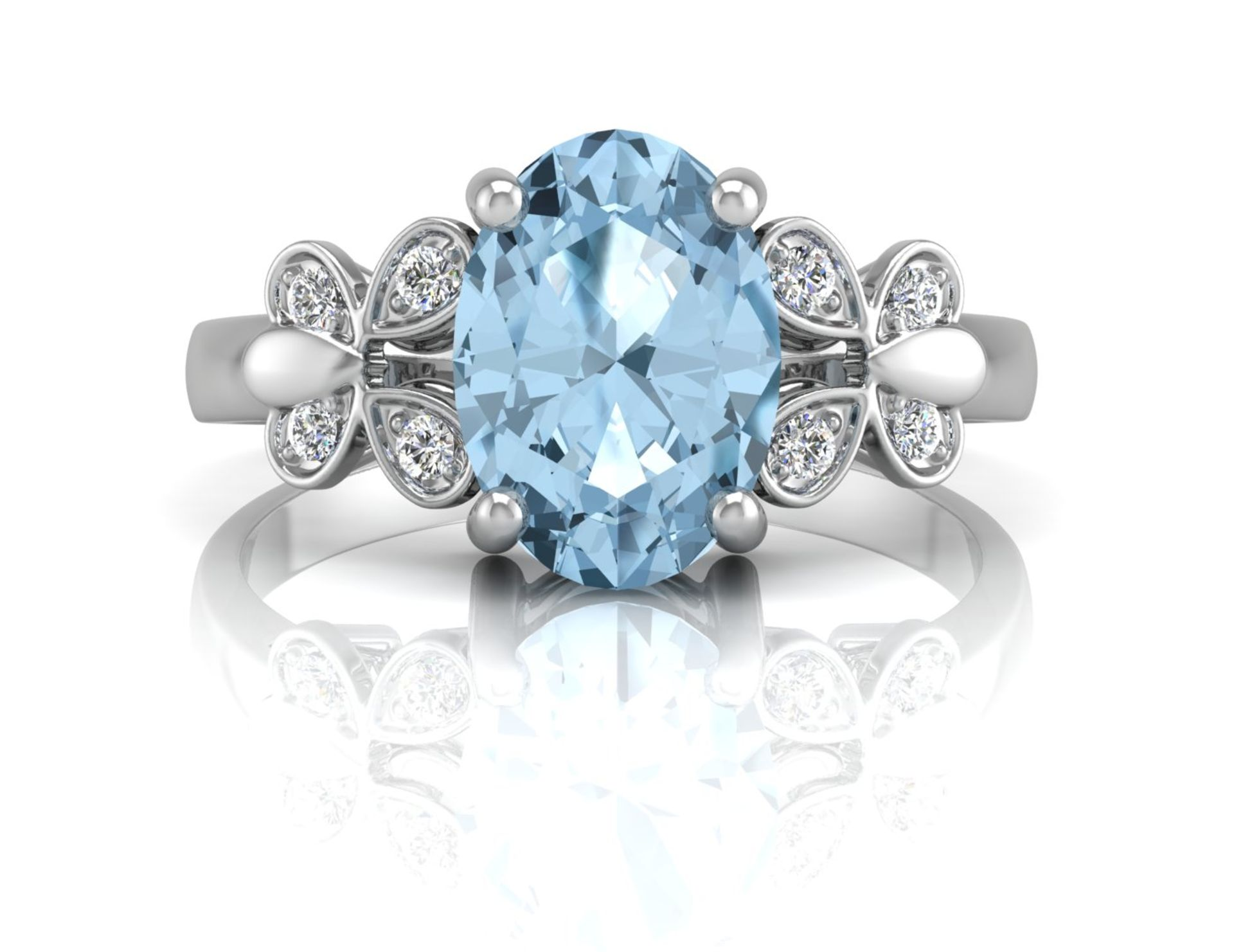 Lot 43 - 9ct White Gold Diamond And Blue Topaz Ring 0.03