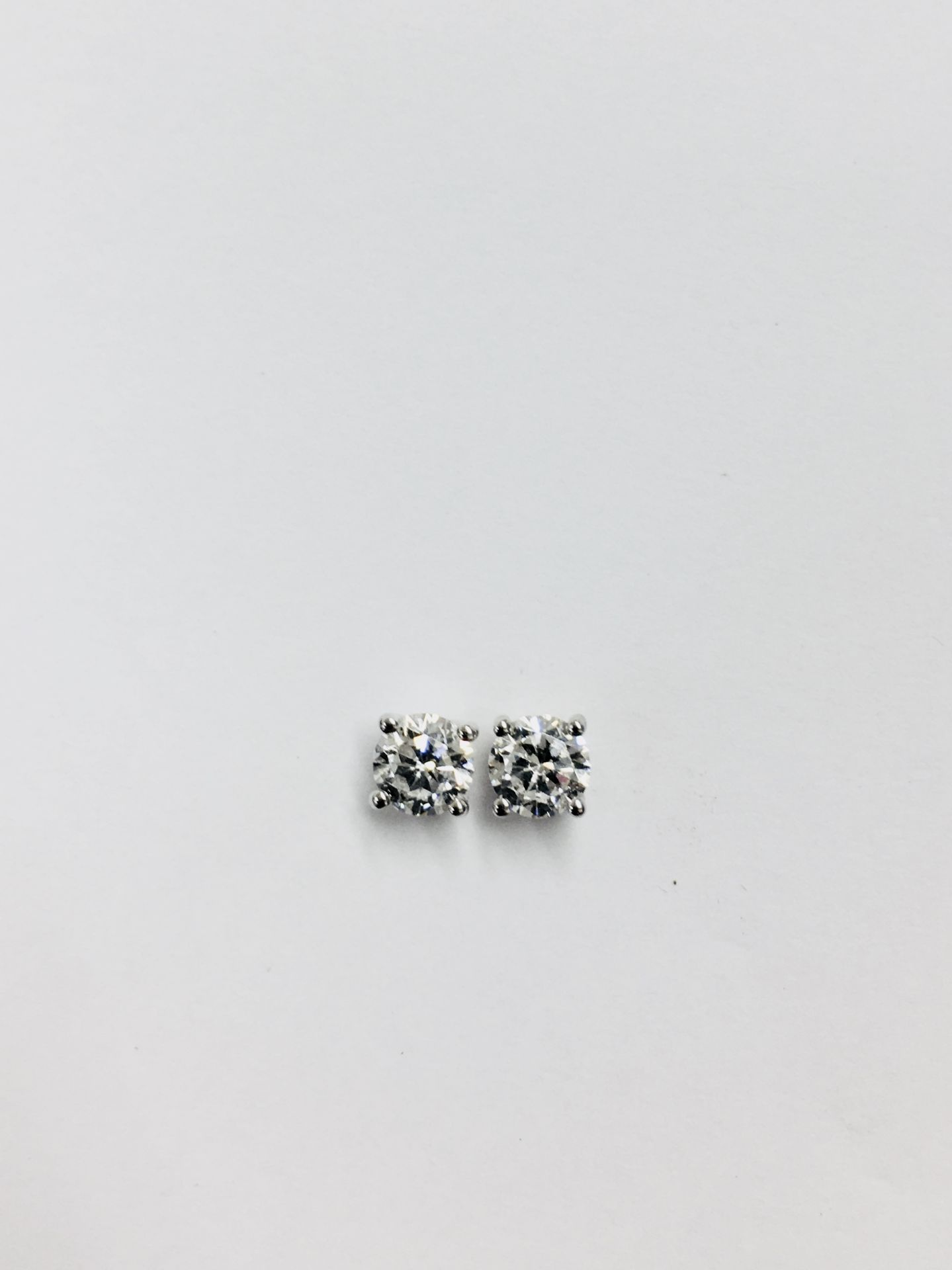 Lot 6 - 0.50ct Solitaire diamond stud earrings set with brilliant cut diamonds, i1 clarity and I colour. Set