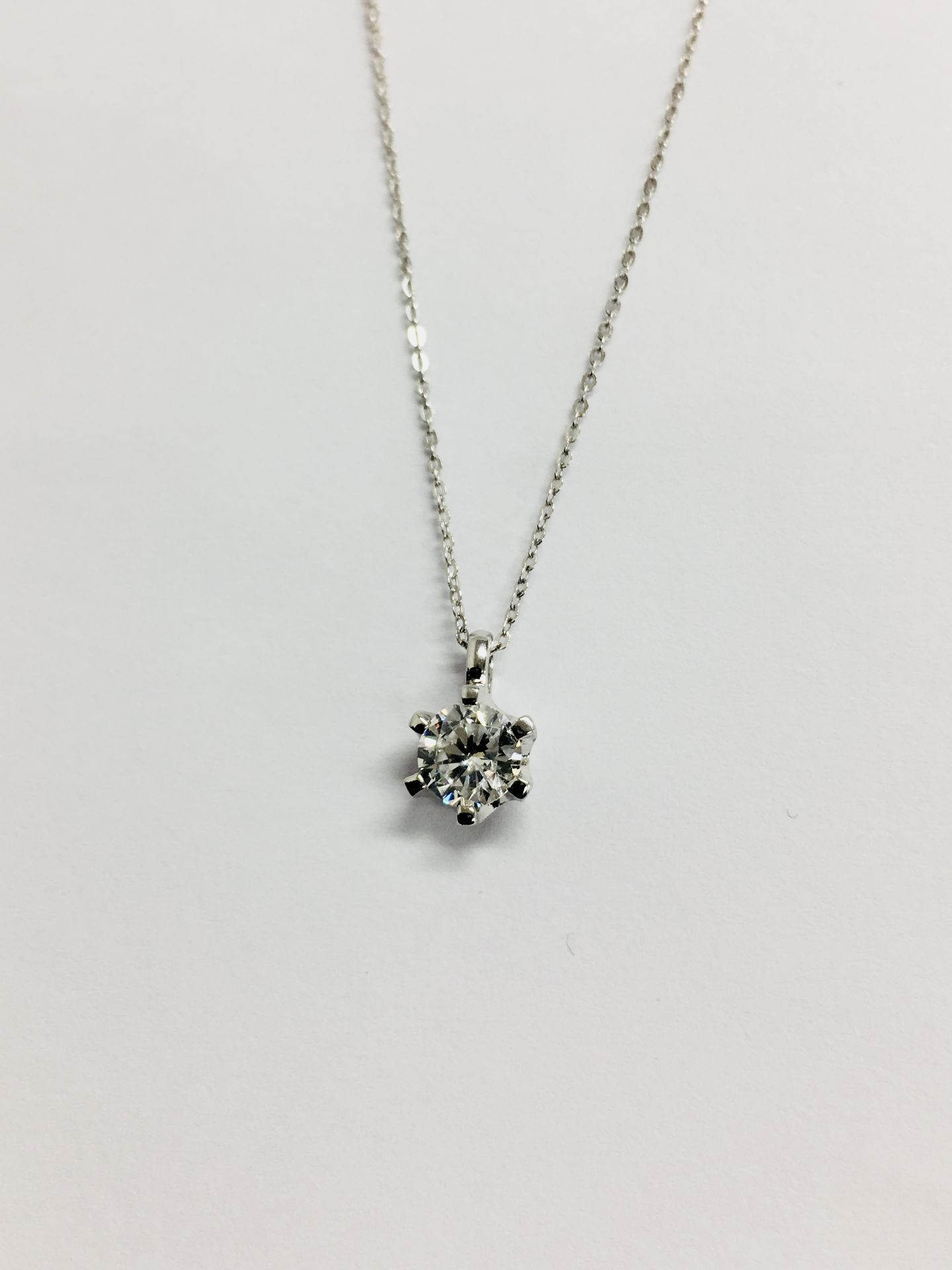 Lot 52 - 0.25ct diamond solitaire pendant set in 18ct gold. 6 claw setting, plain bale. I colour and si3