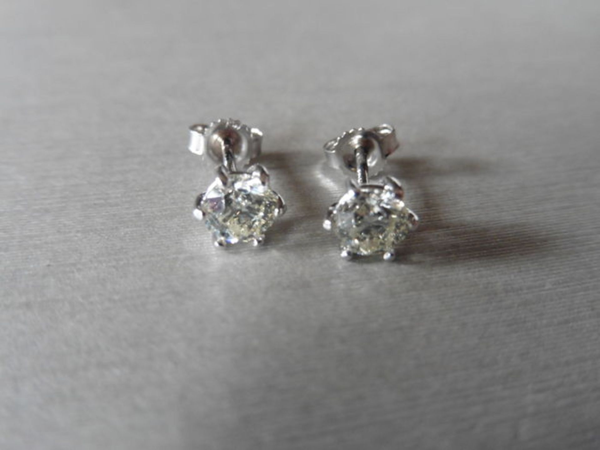 Lot 12 - 1.00ct Solitaire diamond stud earrings set with brilliant cut diamonds, SI3 clarity and H colour.