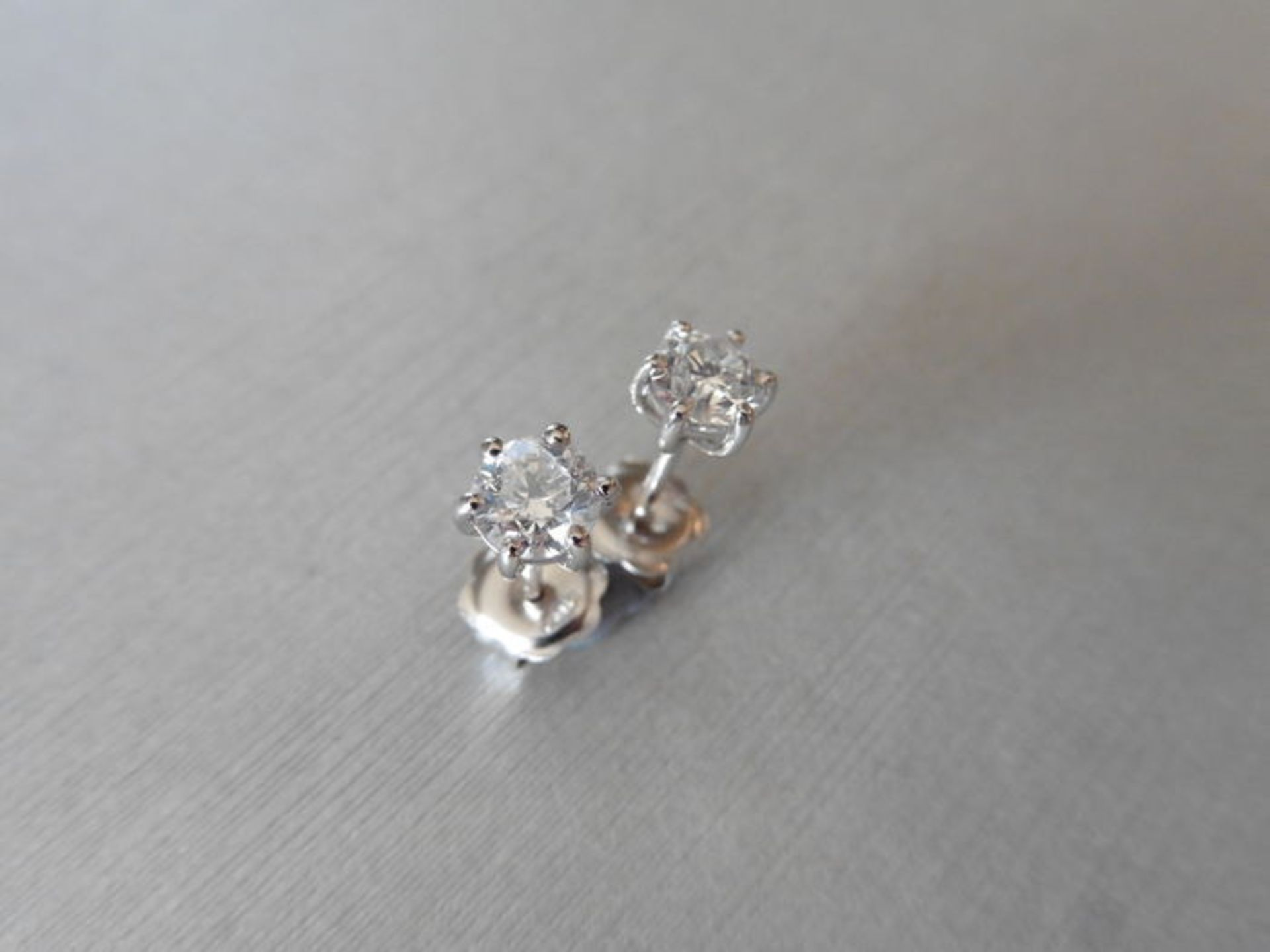 Lot 18 - 0.50ct Solitaire diamond stud earrings set with brilliant cut diamonds, SI2 clarity and I colour.