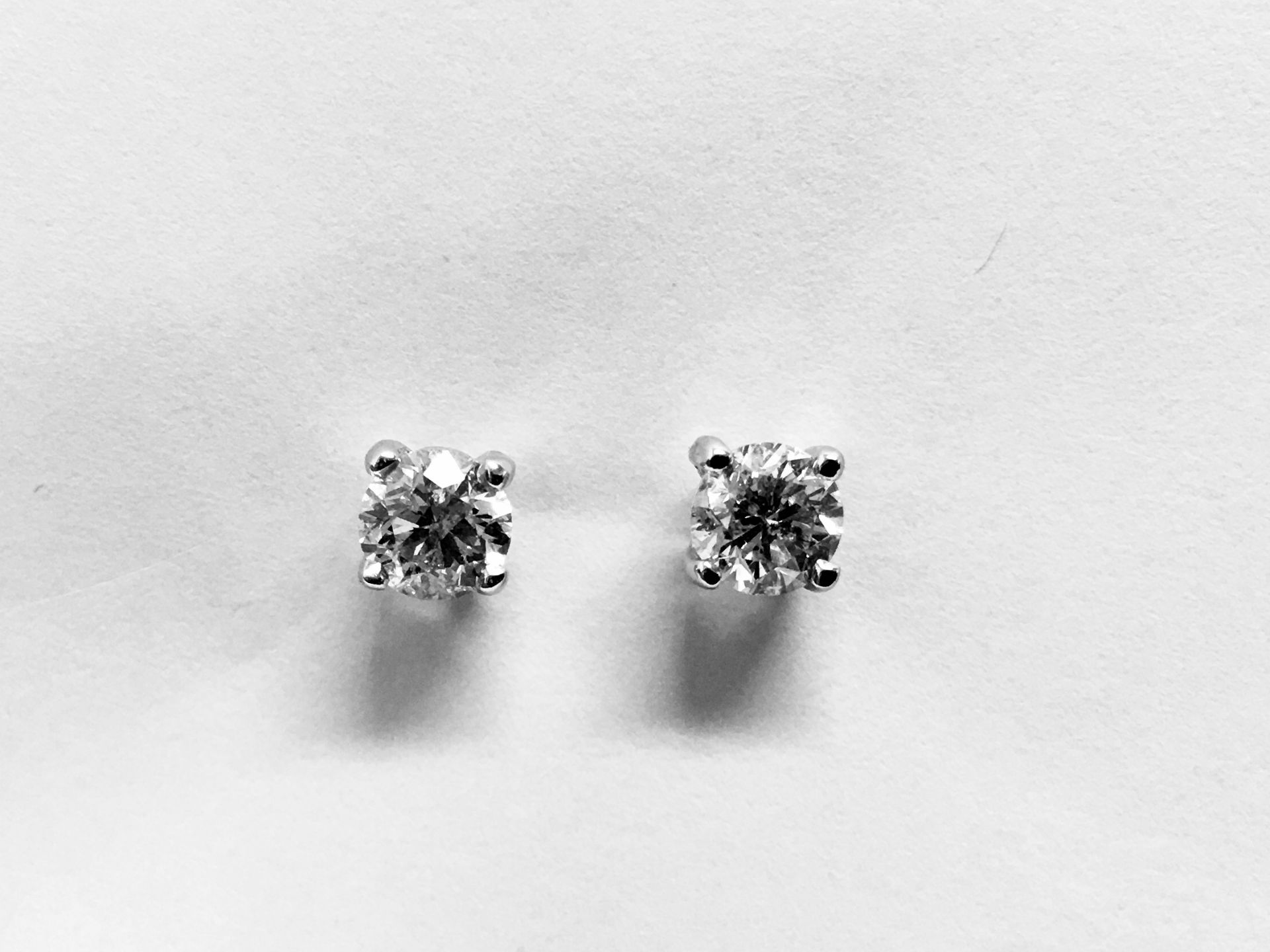 Lot 8 - 0.66ct Solitaire diamond stud earrings set with brilliant cut diamonds, i1 clarity and I colour. Set