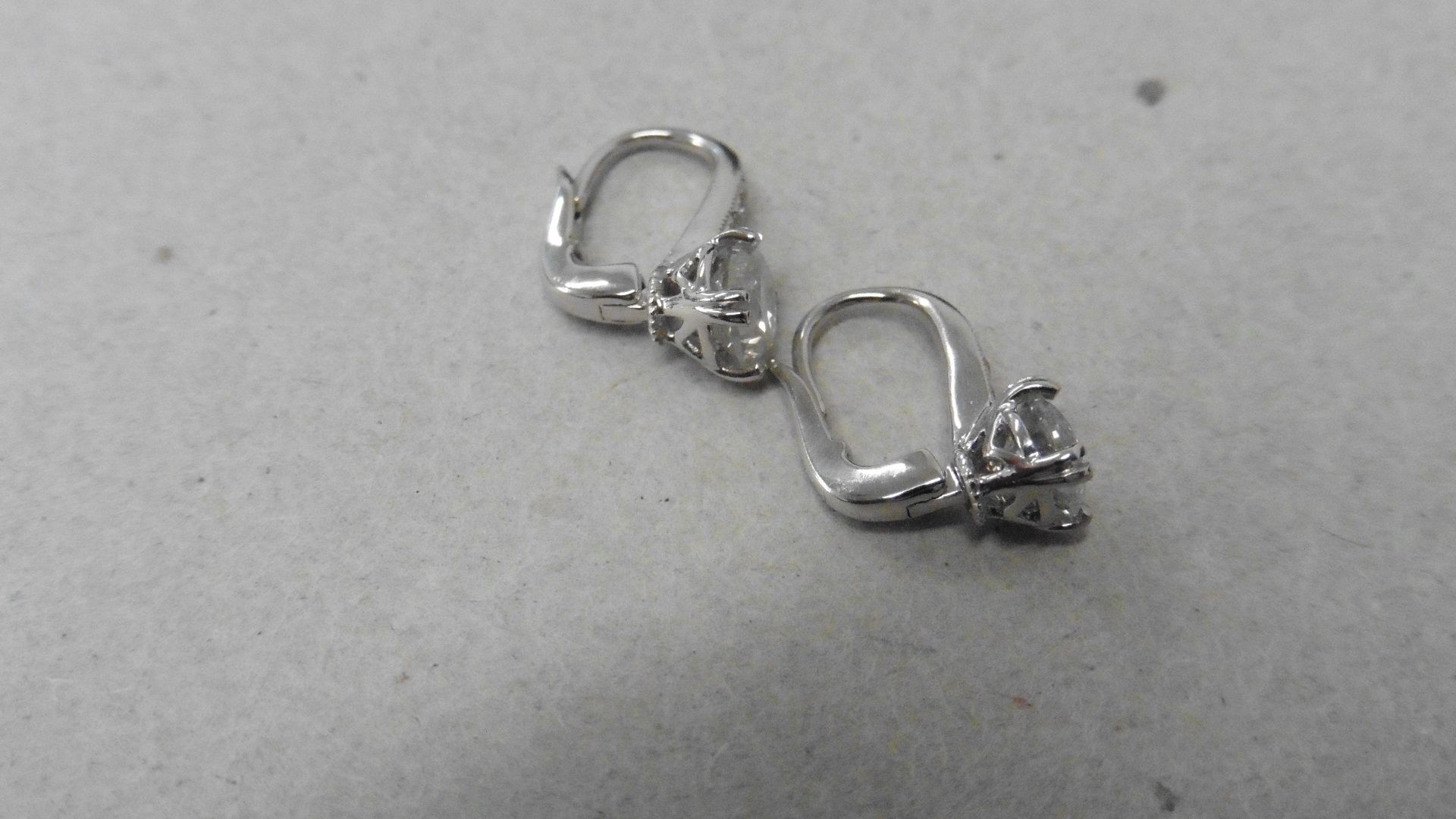 Lot 57 - 18Ct White Gold Hoop Style Earrings With Hinge Fastners.