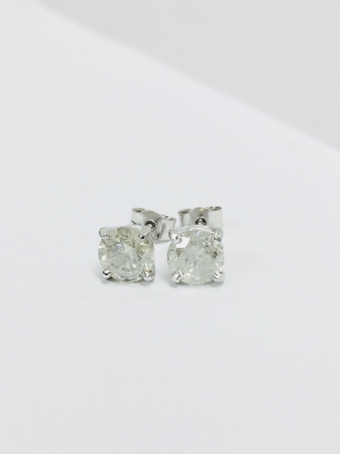 Lot 56 - 2.00Ct Solitaire Diamond Stud Earrings Set With Brilliant Cut Diamonds Which Have Been Enhanced.