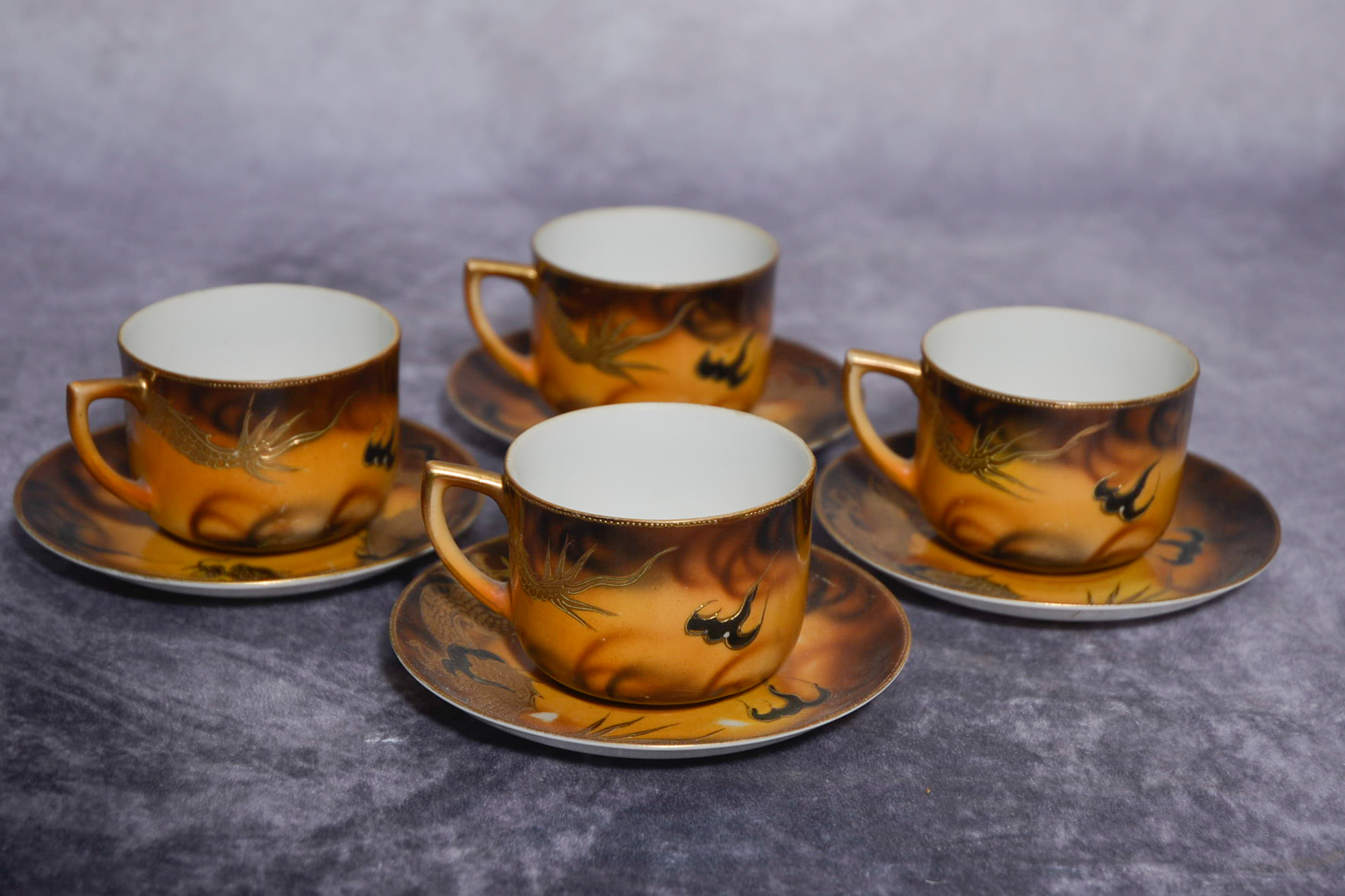 Lot 52 - Set of four Japanese cups and saucers