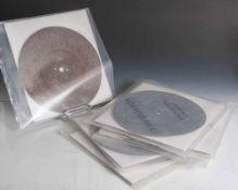 Acht Metallochplatten für Symphonion, einzeln verpackt. Durchm. ca. 23,5cm.