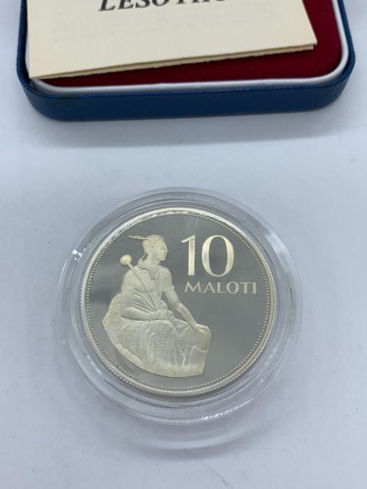 Lot 2 - A silver proof Kingdom Lesotho 10 Maloti coin