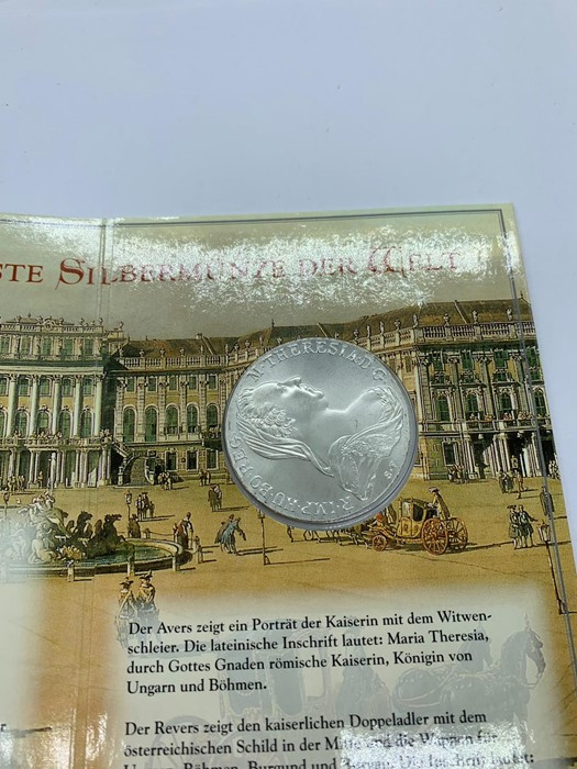 Lot 38 - A Maria Theresa Taler in presentation pack, silver bullion.
