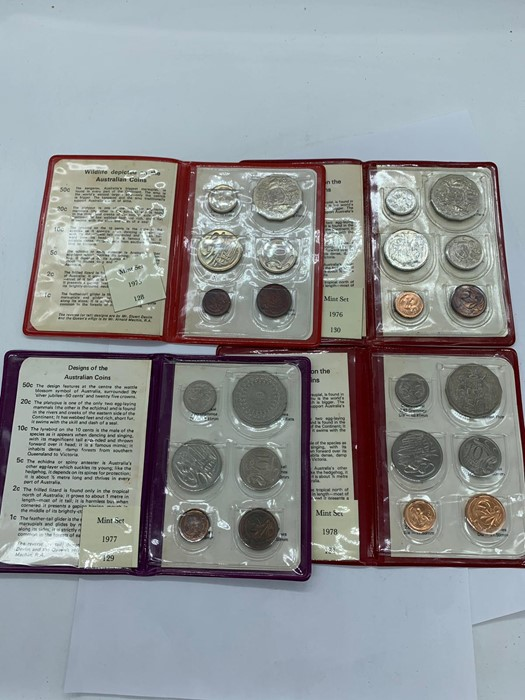 Lot 42 - A selection of four presentation packs from The Royal Australian Mint 1975, 1976, 1978, Silver
