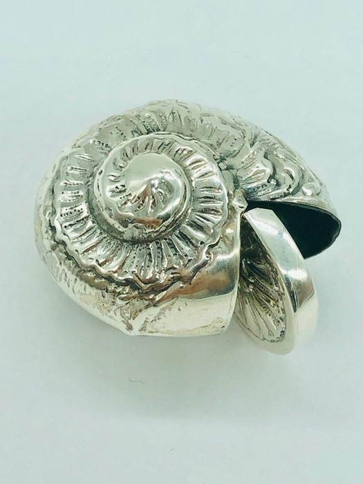Lot 36 - A silver ammonite shaped vesta case