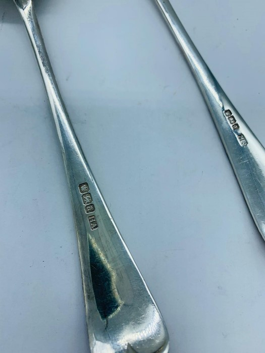Lot 9 - A Pair of decorated silver spoons, hallmarked 1893-94 Sheffield, makers mark HA