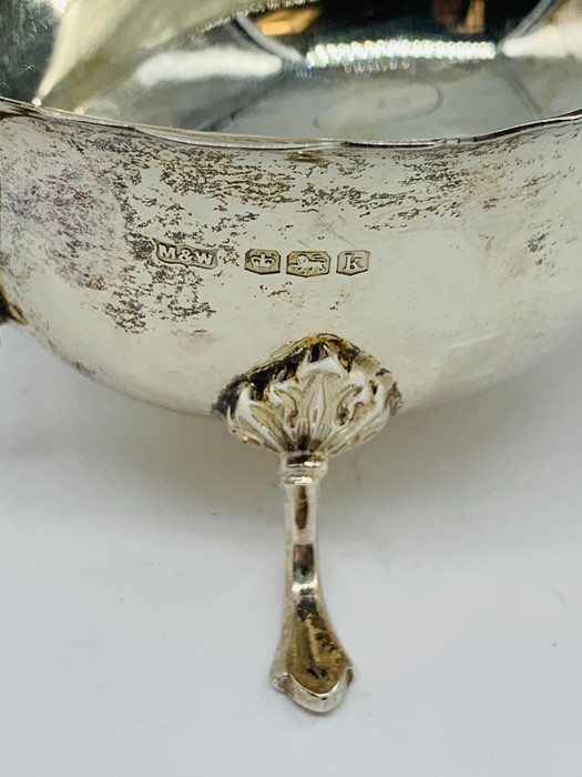 Lot 13 - A Mappin and Webb hallmarked silver sauce boat, 1927-28