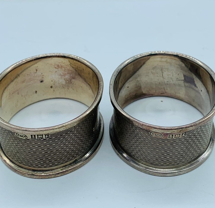 Lot 25 - A pair of hallmarked silver napkin rings