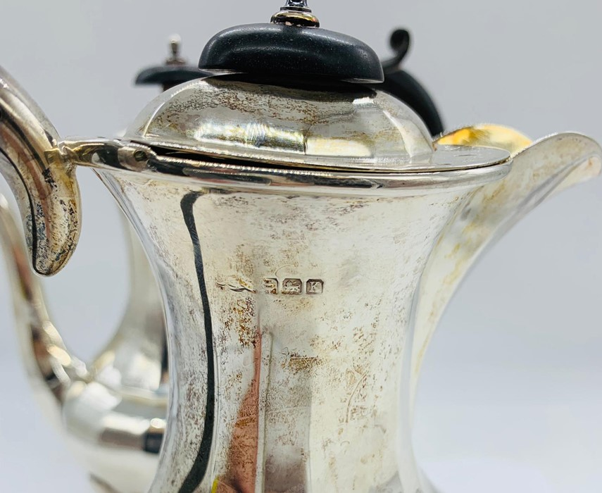 Lot 5 - A pair of silver hallmarked coffee and hot water pots.