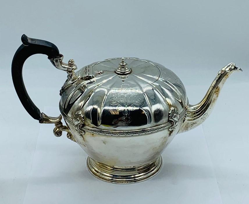 Lot 6 - A Hallmarked silver tea set, comprising tea pot, sugar bowl and milk jug, hallmarked 1924-25 (