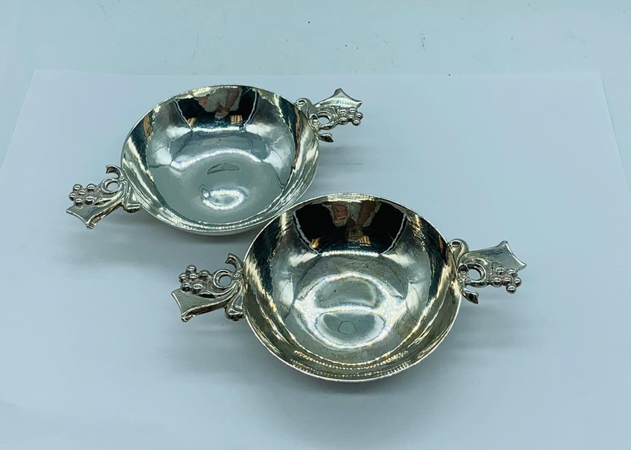 Lot 3 - A Pair of Asprey, hallmarked silver wine tasting cups. London 2009.